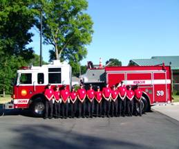 Teenagers standing in front of a fire truck